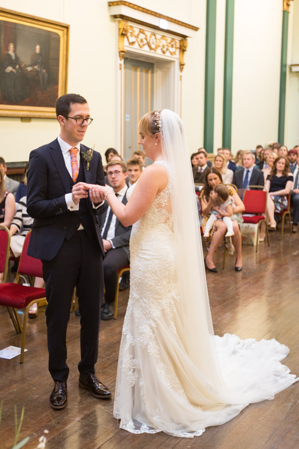 Bride and groom exchange rings at Cutlers' Hall Sheffield