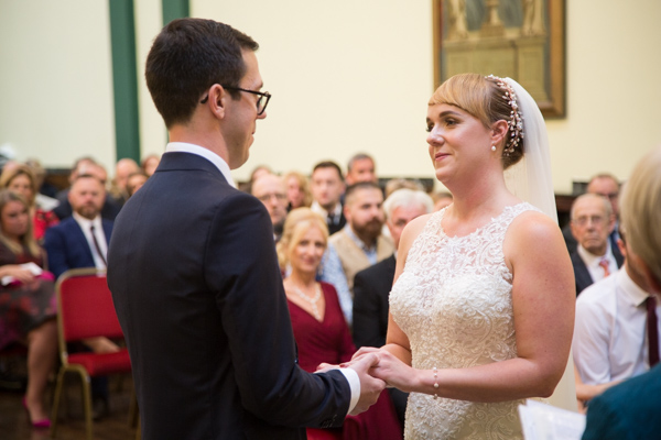 Bride and Groom smiling at each other during the ceremony at Cutlers' Hall Sheffield