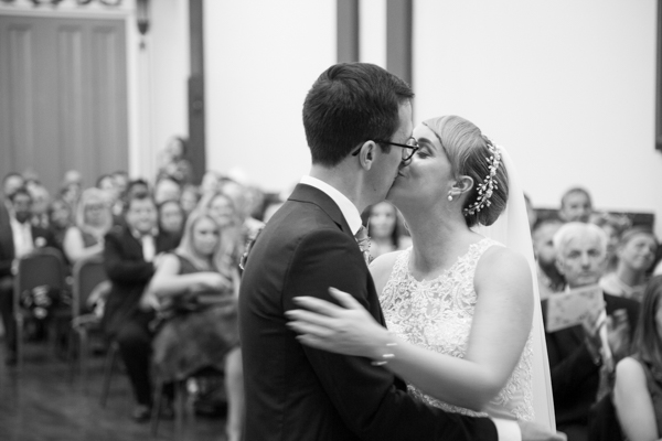 Bride and groom kiss at Cutlers' Hall Sheffield