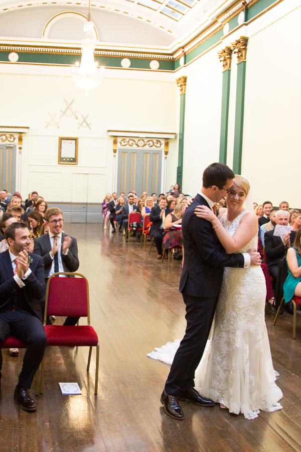 Bride and groom laughing during their wedding ceremony at Cutlers' Hall Sheffield