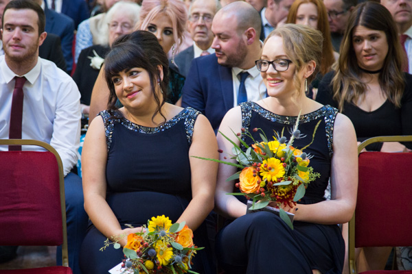 Bridesmaids during the wedding ceremony at Cutlers' Hall Sheffield