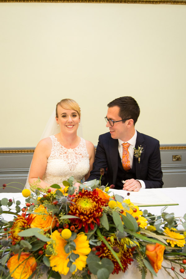Bride and Groom signing the register at Cutlers' Hall Wedding Sheffield