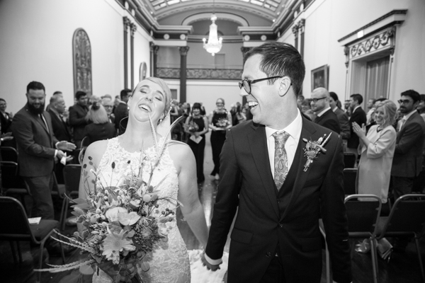 Bride and Groom leaving the ceremony room at Cutlers' Hall Sheffield