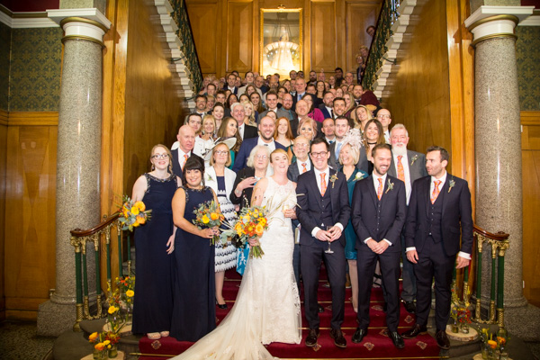All the wedding guests on the grand staircase at Cutlers' Hall Sheffield