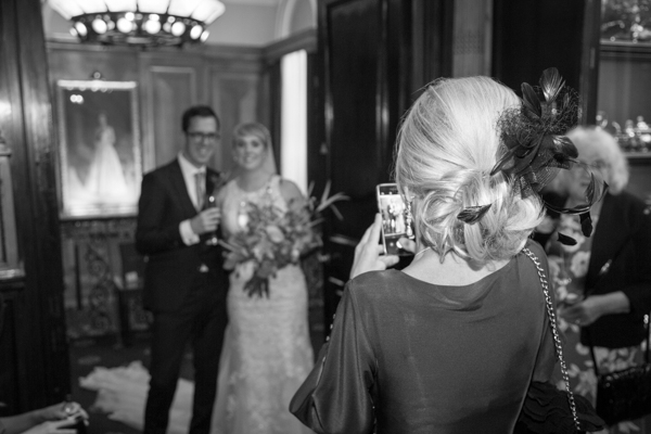 Guest taking photographs of the bride and groom at Cutlers' Hall Sheffield Wedding