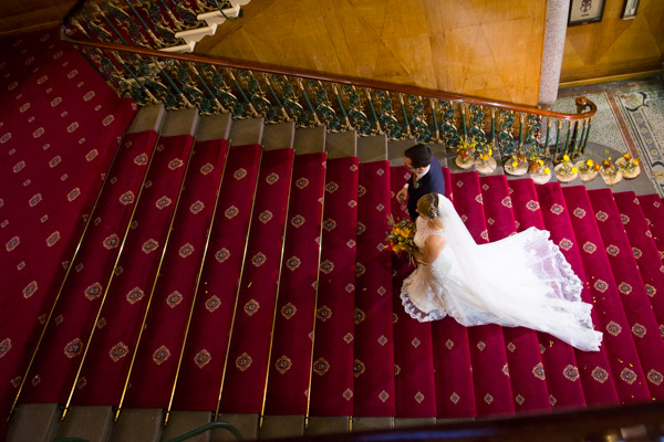 Bride and groom walking up the staircase at Cutlers' Hall Sheffield
