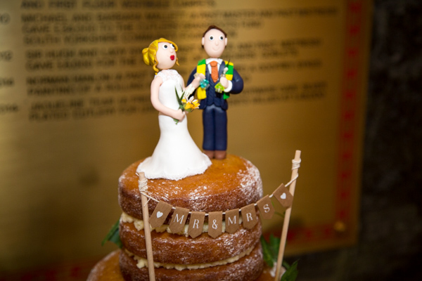 Bride and Groom cake topper with Mr & Mrs paper banner