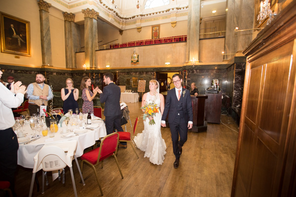 Bride and groom walking to their seats at Cutlers' Hall Sheffield
