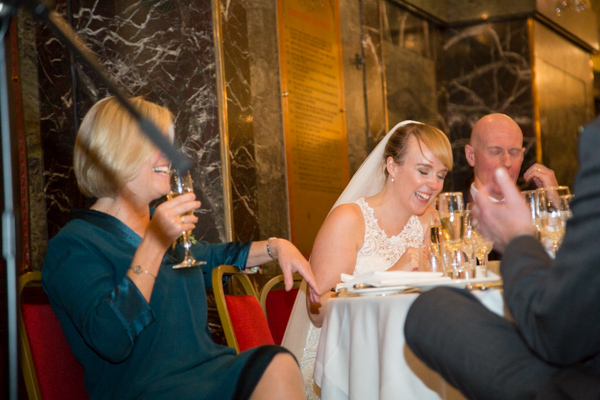 Bride laughing during Grooms speach at Cutlers' Hall Sheffield
