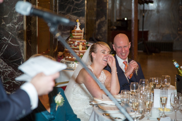 Bride and father of the bride laughing during speeches at Cutlers' Hall Sheffield