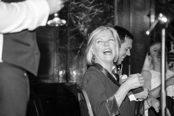 Mother of the bride laughing during speeches at Cutlers' Hall Sheffield