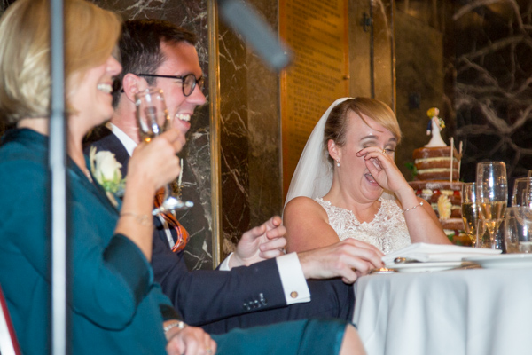 Bride laughing during speeches at Cutlers' Hall Sheffield