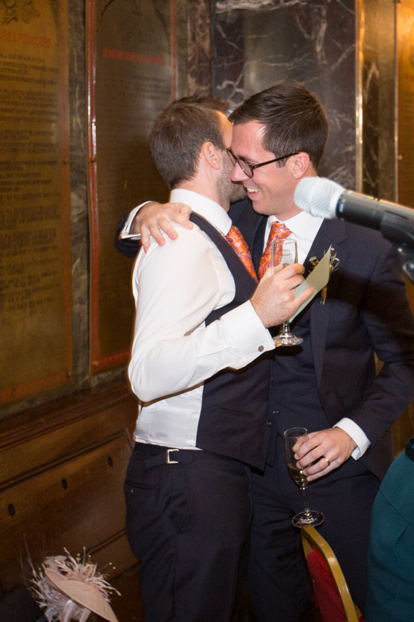 Groom hugging best man after the speeches at Cutlers' Hall Sheffield
