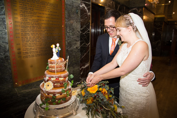 Bride and Groom cutting the cake at Cutlers' Hall Sheffield Wedding