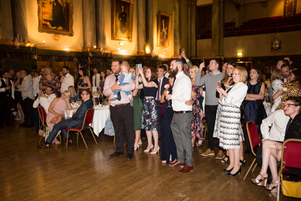 Guest watching and filming the first dance at Cutlers' Hall Sheffield