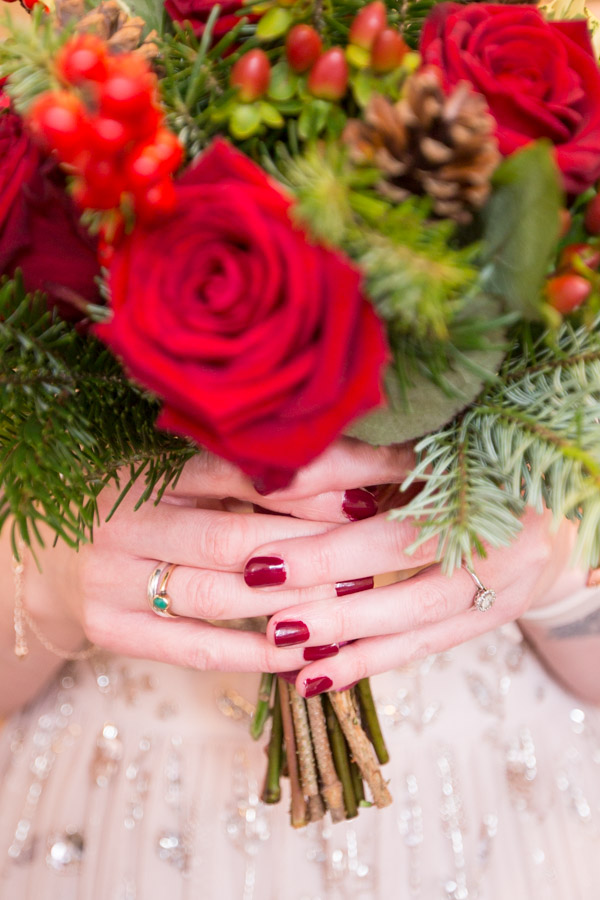 The Bride with her red rose bouquet and her engagement rings Barnsley Town Hall Wedding