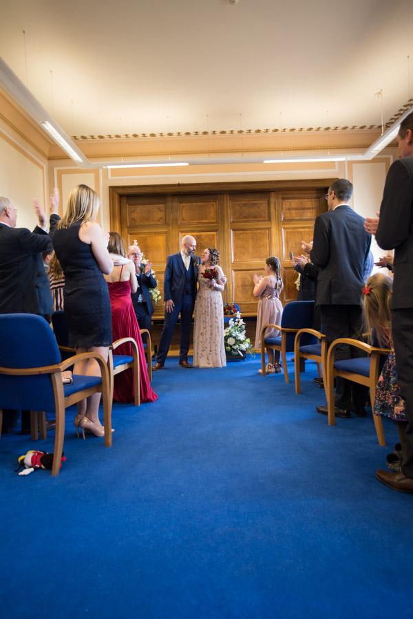 Bride and groom leaving the ceremony room Barnsley Town Hall Wedding