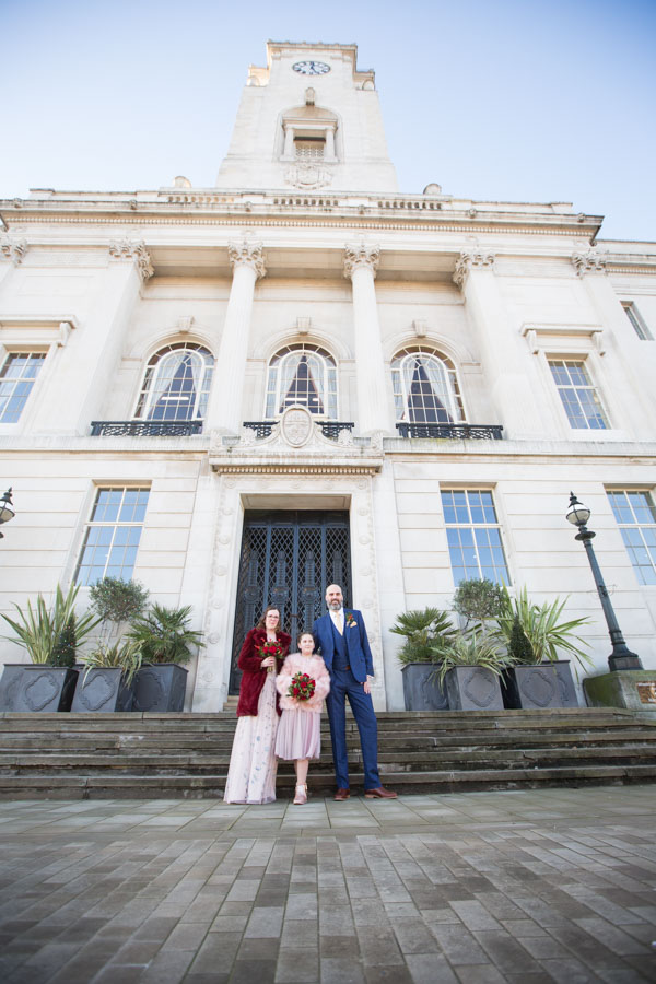Bride and Groom with their daughter outside Barnsley Town Hall Wedding