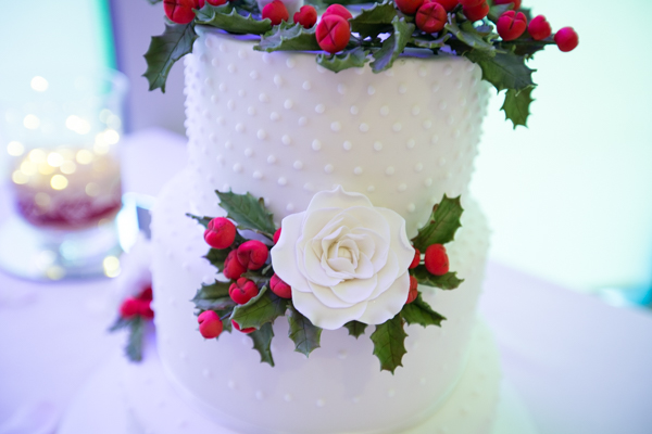 White rose detail on Christmas themed wedding cake at Ibis Styles Hotel Barnsley wedding