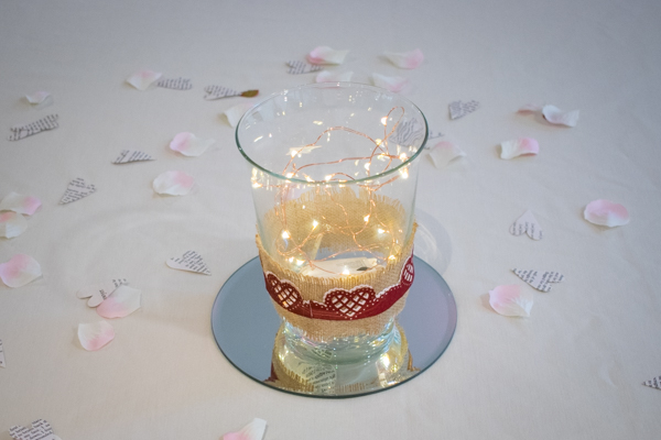 Lights in a vase with red paper hearts to decorate at Ibis Styles Hotel Barnsley wedding