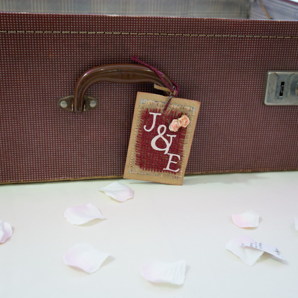 J & E luggage tag on the wedding card box at Ibis Styles Hotel Barnsley wedding