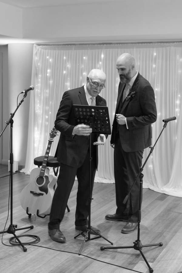 Groom and Father of the Groom setting up microphone at Ibis Styles Hotel Barnsley wedding