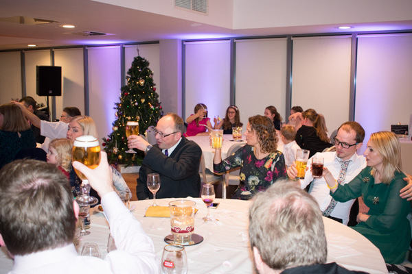 Wedding guests raising a toast at Ibis Styles Hotel Barnsley wedding