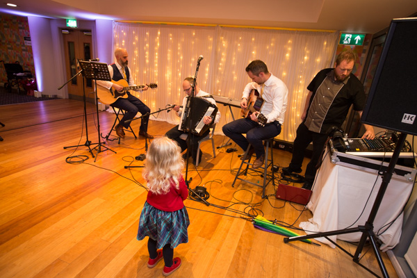 Child watching the wedding band at Ibis Styles Hotel Barnsley on the wedding day