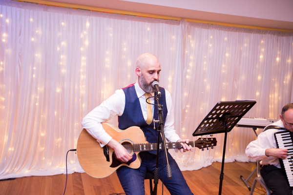 Groom playing guitar at Ibis Styles Hotel Barnsley on the wedding day