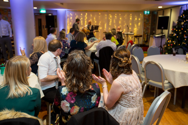 Guests applauding wedding band at Ibis Styles Hotel on the wedding day