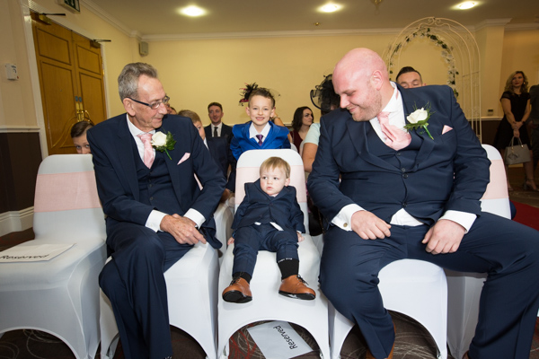 Groomsmen waiting for the ceremony to begin with one of the page boys at Holiday Inn Barnsley