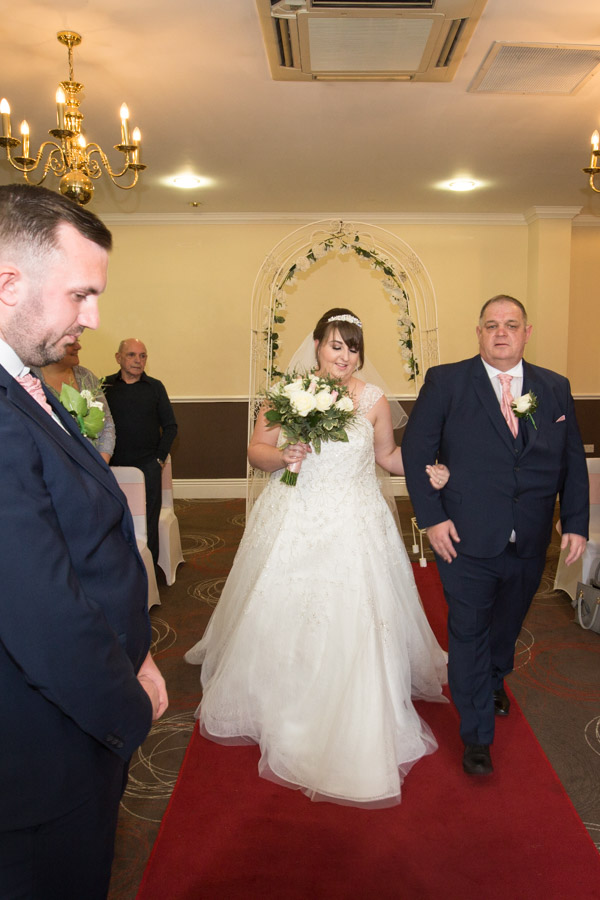 Bride walking down the aisle at Holiday Inn Barnsley