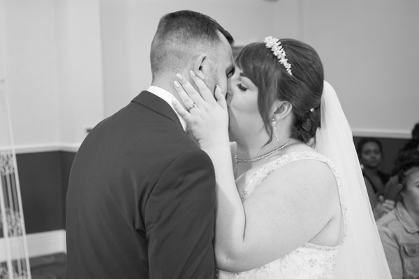 Bride and groom kiss at Holiday Inn Barnsley