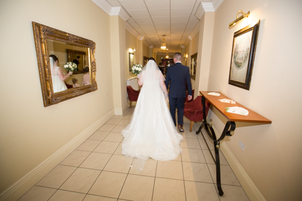 Bride and groom walking together at Holiday Inn Barnsley