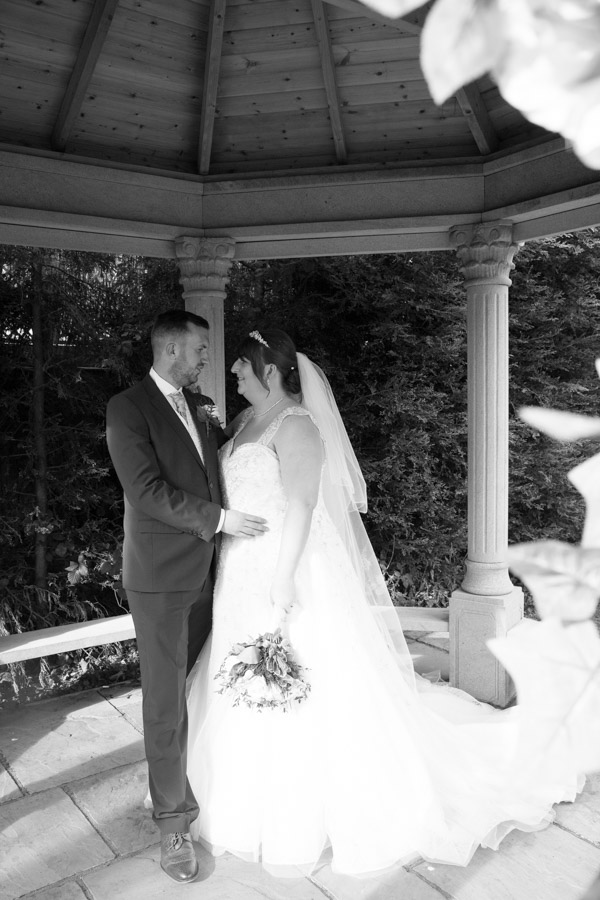 Bride and groom inside the secret garden at Holiday Inn Barnsley
