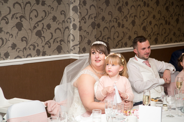 Bride smiling during speeches at Holiday Inn Barnsley