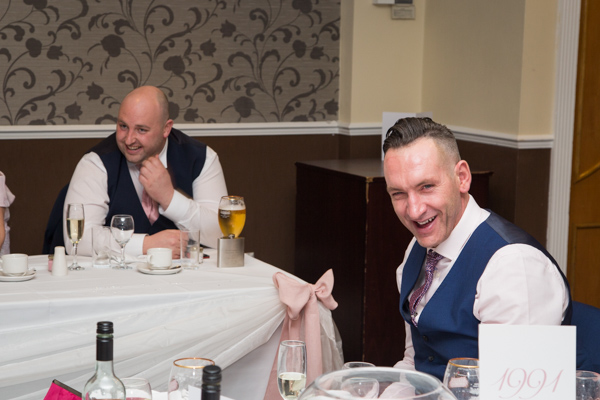 guests laughing during speeches at Holiday Inn Barnsley