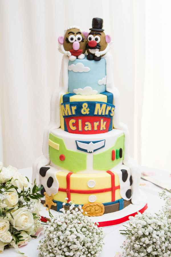 Toy Story wedding cake by Quite Contrary Cakes with Mr & Mrs Potato Head cake topper