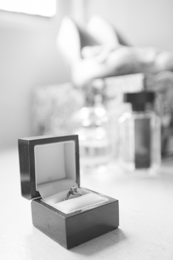 The engagement ring with acessories and perfume in the background at The Rockingham Arms