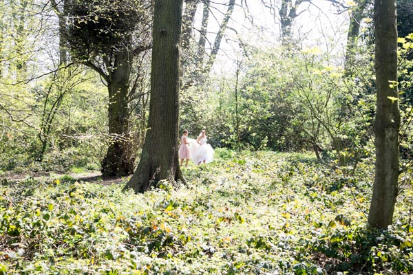 Bride and Bridesmaid walking through the woods to Wentworth Church