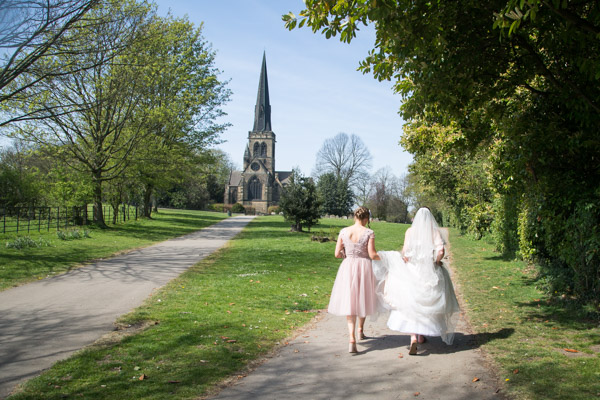 Bride and Bridesmaid walking to Wentworth Church