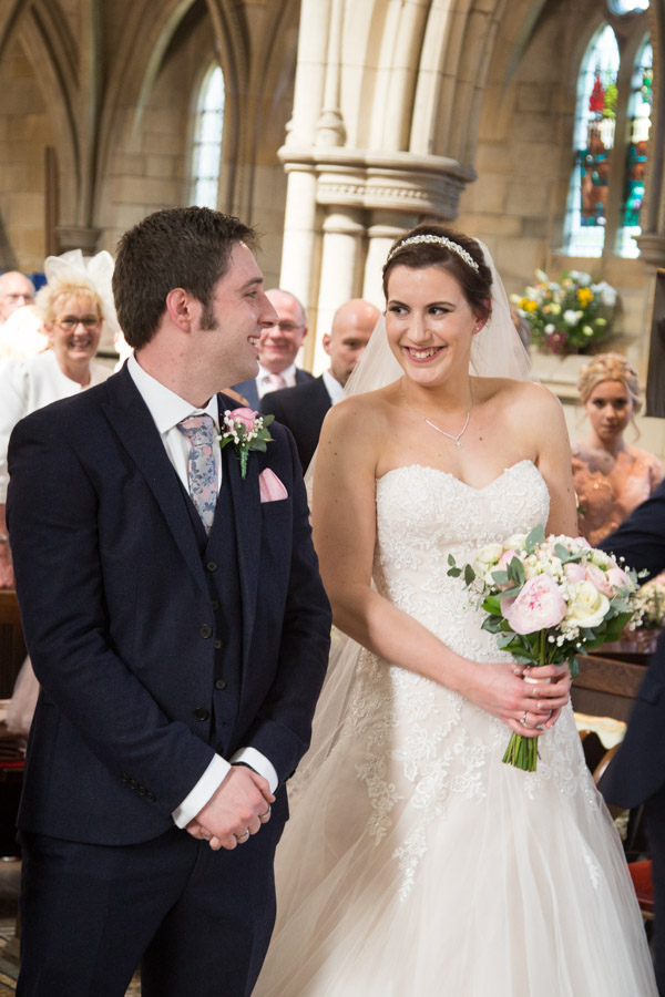 Bride and Groom smiling at each other in Wentworth Church
