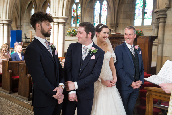 Groom looking at his guests at Wentworth Church wedding ceremony