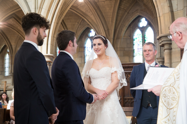 Bride and groom exchange rings at Wentworth Church wedding ceremony