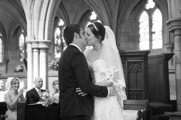 Bride and Groom kiss at Wentworth Church wedding ceremony