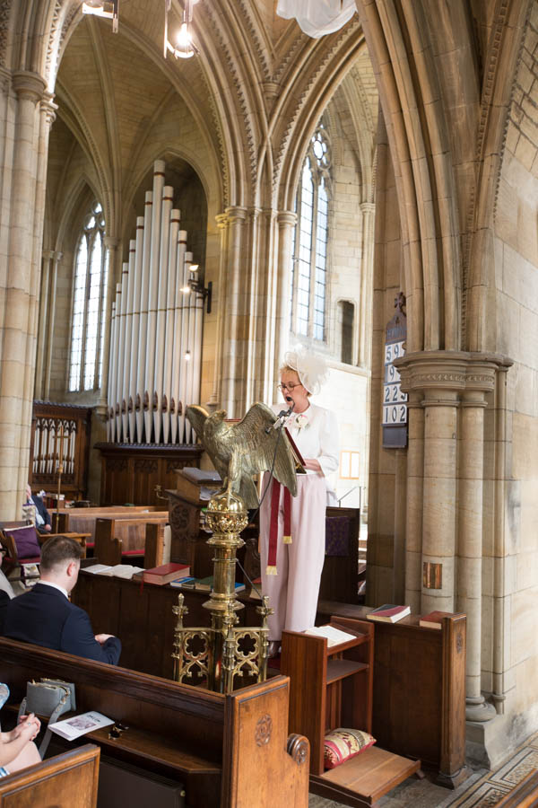 Mother of the bride saying a reading at Wentworth Church wedding ceremony
