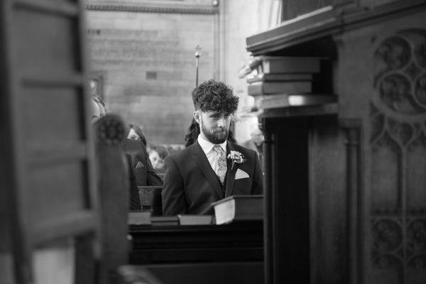 Best man pulling faces at Wentworth Church wedding ceremony
