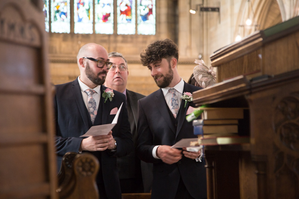 Groomsmen chatting at Wentworth Church wedding ceremony