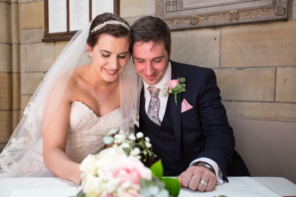 Bride and Groom sign the register at Wentworth Church wedding ceremony