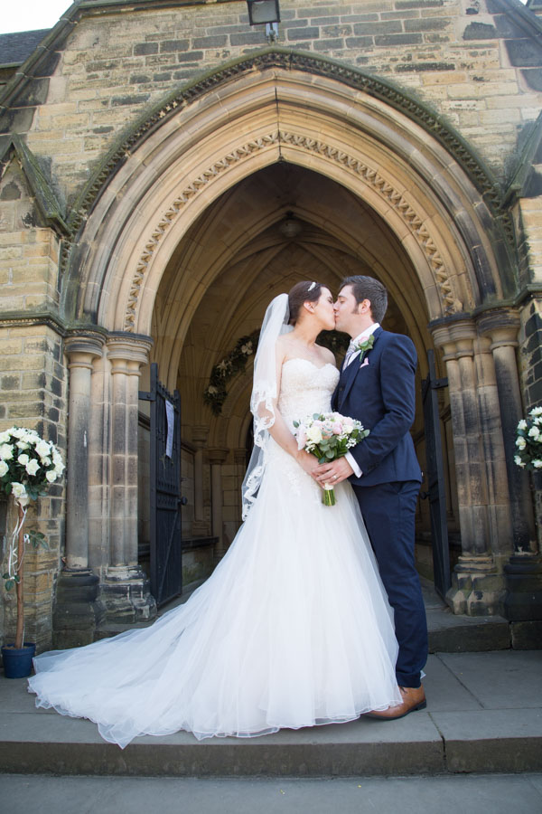 Bride and Groom kiss on the steps outside Wentworth Church